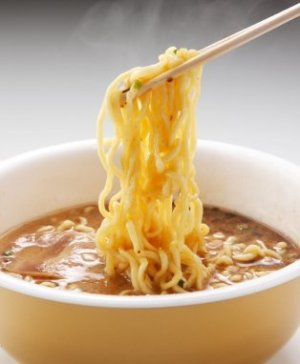 Ramen Noodles Being Lifted by Chopsticks