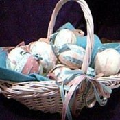 Basket of fabric wrapped foam eggs.