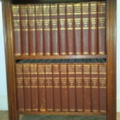 Two shelf bookcase with Britannica.