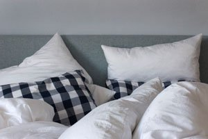 Pillows and Sheets on Bed