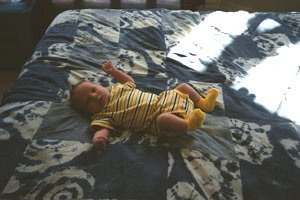 Baby on Blue Quilt