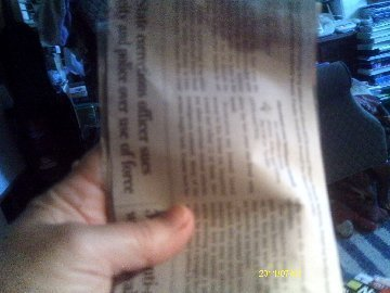 A piece of newspaper for making a seed pot.