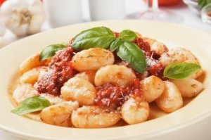 Gnocchi on Plate With Basil and Tomato