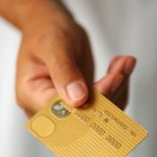Hand With Gold Credit Card