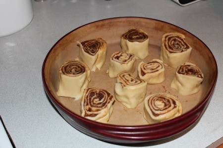 A pan of cinnamon rolls before being baked.