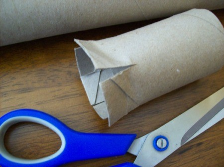 Cutting the paper towel tube.
