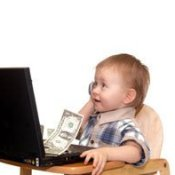 Child With Laptop, Money and Cell Phone