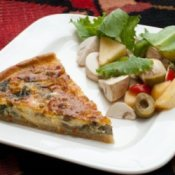 Quiche Being Served on White Plate