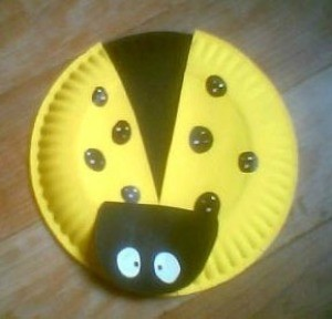 A ladybug kids craft made from a paper plate.