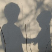 Shadows of Boys holding hands