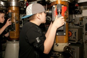 Boy Looking Through Submarine Periscope