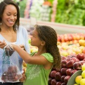 Mother and Daughter Shopping at Supermarket