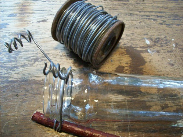 Attaching wire to the jar.