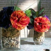 Beautiful coffee filter flowers in jars fiilled with rocks