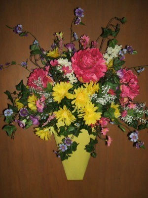 Spring floral wall bucket using artificial flowers.