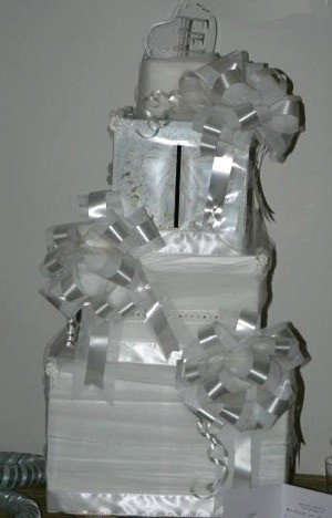 White fake cake of boxes and bows