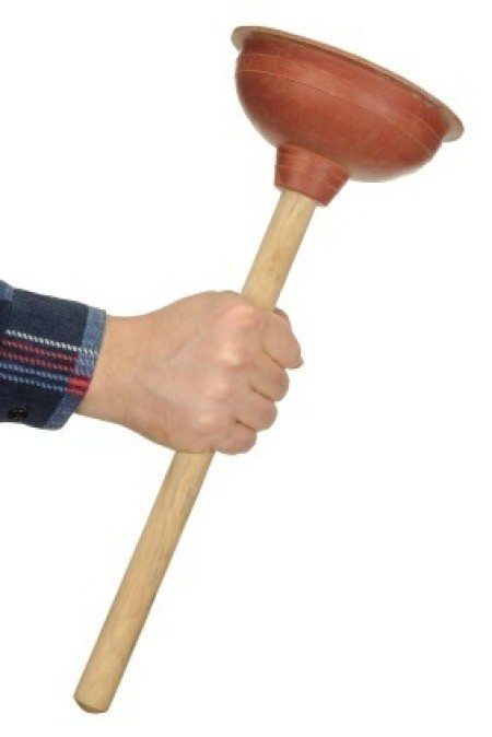 Man Holding Plunger