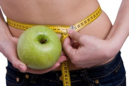Woman Measuring Her Waist Holding Apple
