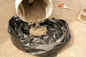 Pouring Concrete into Garbage Bag for Hypertufa Pot