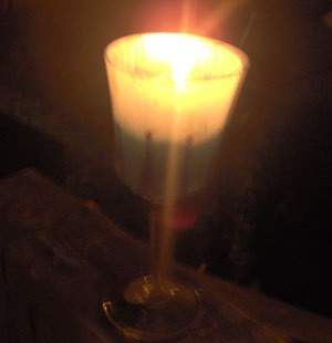 Lit Recycled Goblet Candle Holder
