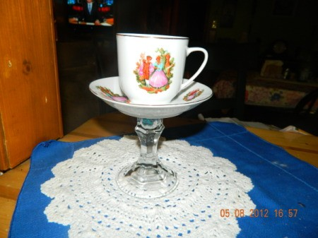 A pedestal server for a tea cup.