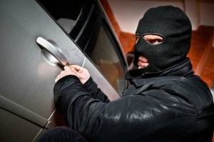 Thief Breaking into Car