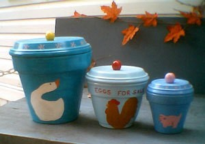 Clay pot canisters painted in blues.
