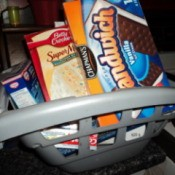 Plastic shopping cart holding food boxes repurposed as child's play food