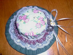 Hat shaped pin cushion holder.