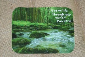 Mouse pad with woodland stream photo.