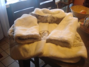 White fur coat to be stored.