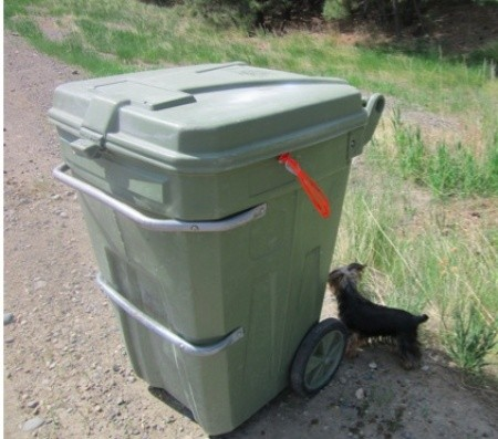 Trash can with pull tie showing.