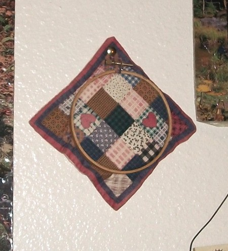 Printed quilt block in embroidery hoop.