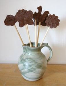 Garden stakes in ceramic jar.
