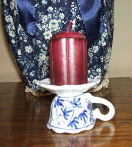 Cup and saucer candle holder.