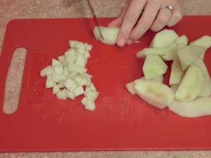 Chopping apples for egg rolls.