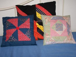 Pillows made from quilt squares.