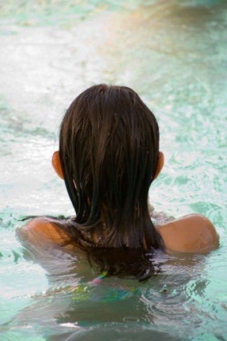 Girl with Long Hair in Swimming Pool