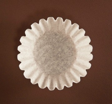 Coffee Filter on Brown Background