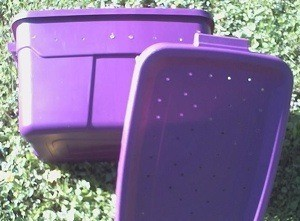 Photo of a pet carrier made from a plastic tub.