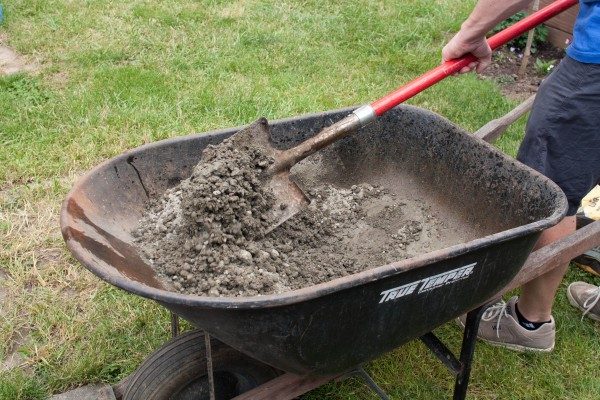 Mixing Concrete in Wheelbarrow