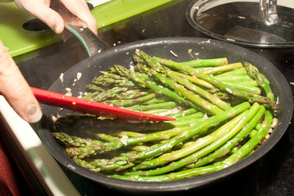 Lemon Ginger Asparagus being sauteed in a pan.
