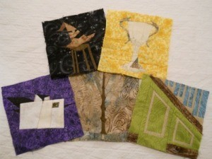 Five paper pieced quilt blocks.