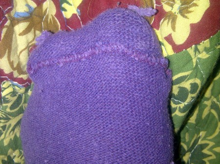 A purple sock worn inside out.