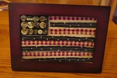 "Scrappy framed flag with button ""stars""."