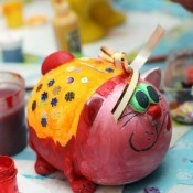 A photo of a piggy bank painted by a child.
