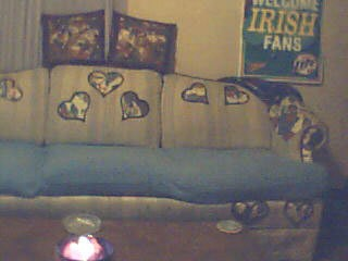 Heart shaped fabric glued onto back of couch.