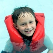 Boy in Life-vest in Swimming Pool