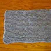 Knitted rectangular cozy.