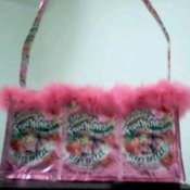 Pink purse made from pouches and pink trim.